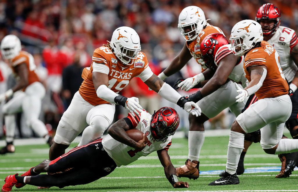 SAN ANTONIO, TX - DECEMBER 31:  Tyler Huntley #1 of the Utah Utes is sacked by Ta'Quon Graham #49 of the Texas Longhorns in the second quarter during the Valero Alamo Bowl at the Alamodome on December 31, 2019 in San Antonio, Texas.  (Photo by Tim Warner/Getty Images)