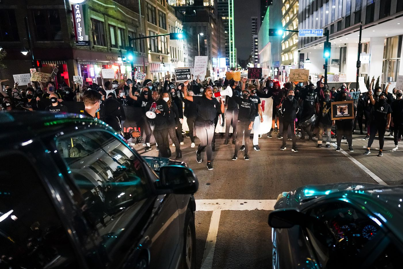 Demonstrators block traffic as they march on Elm Street in downtown Dallas after a Kentucky grand jury brought no charges against Louisville police for the killing of Breonna Taylor on Wednesday, Sept. 23, 2020.