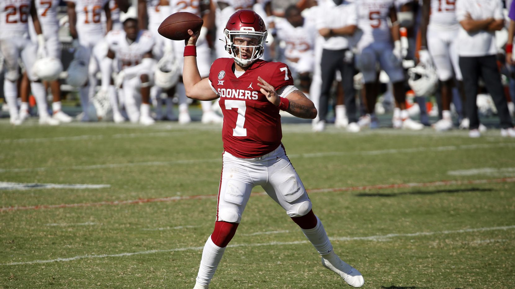 Oklahoma Sooners quarterback Spencer Rattler (7) throws a two-point conversion following the winning touchdown against the Texas Longhorns in the Red River Rivalry at the Cotton Bowl in Dallas, Saturday, October 10, 2020. Oklahoma won in quadruple overtime, 53-45.