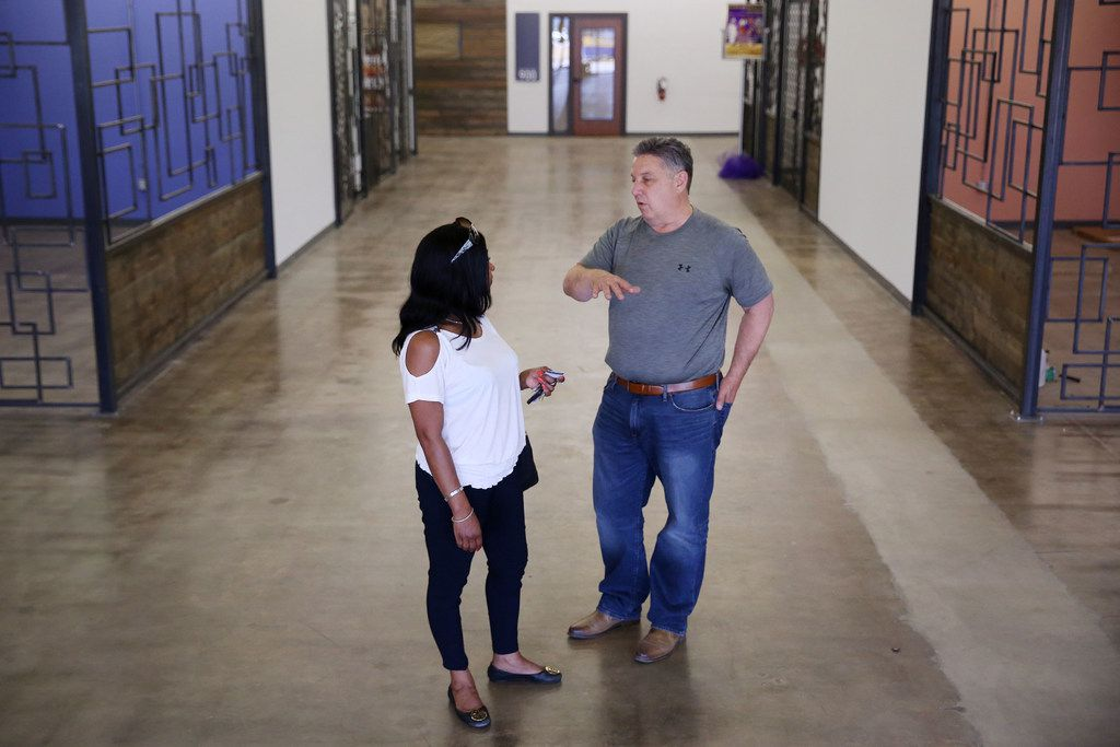 Karen Norman of Lancaster speaks to Monte Anderson after Norman walked DeSoto Market Place as she looks for a space to sell mid-modern furnishings.