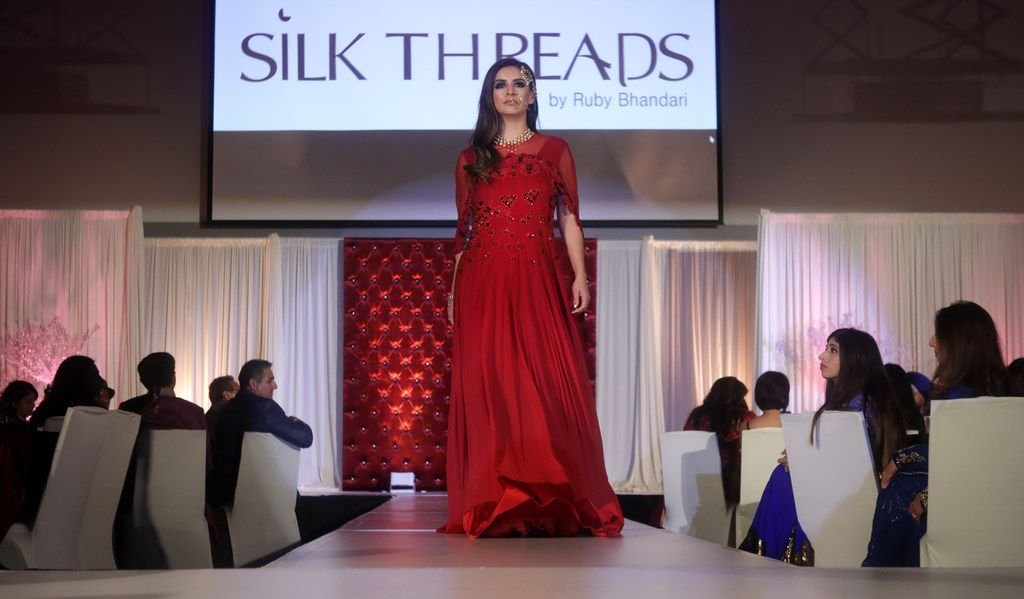 Models walk the runway during the Bollywood to Hollywood charity gala at the University of Texas at Dallas' Davidson-Gundy Alumni Center in Richardson, TX, on Oct. 14, 2017.
