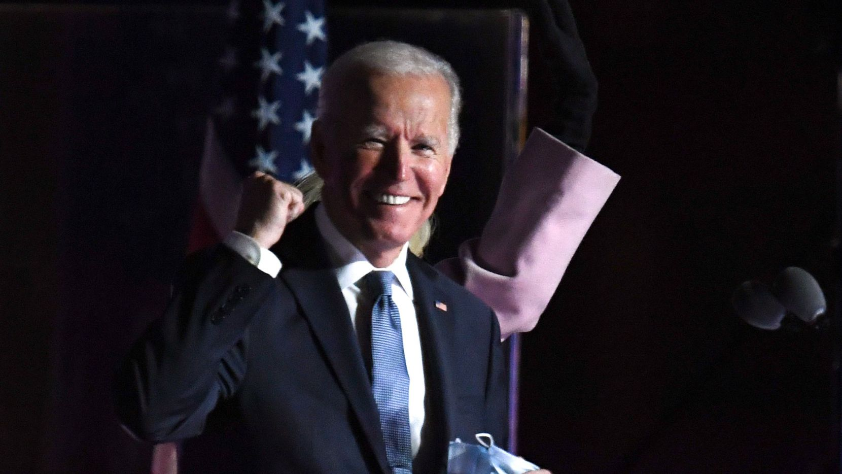 Democratic presidential nominee Joe Biden gestures as he arrives onstage to address supporters on election night at the Chase Center in Wilmington, Del., early on November 4, 2020.