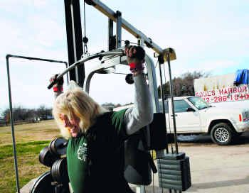 Salvatore Caudo lifted weights last month at a workout station he created from donated equipment at Soul's Harbor. Caudo, a former crack addict who is in recovery at the shelter, said the exercise has helped him stay away from drugs.
