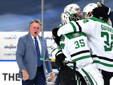 FILE — Head coach Rick Bowness of the Dallas Stars reacts and watches as his players celebrate on the ice after the Stars 3-2 overtime win against the Golden Knights in Game Five of the Western Conference Final of the 2020 NHL Stanley Cup Playoffs between the Dallas Stars and the Vegas Golden Knights at Rogers Place on September 14, 2020 in Edmonton, Alberta.