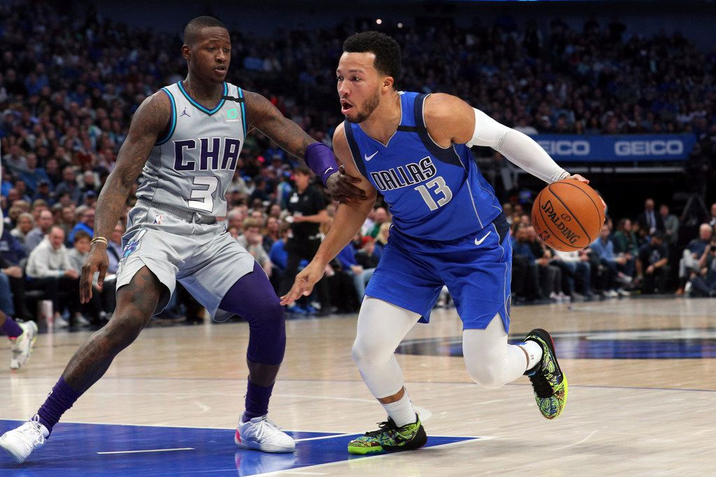 Charlotte Hornets guard Terry Rozier (3) Dallas Mavericks guard Jalen Brunson (13) in an NBA basketball game Saturday, Jan. 4, 2020, in Dallas. (AP Photo/Richard W. Rodriguez)