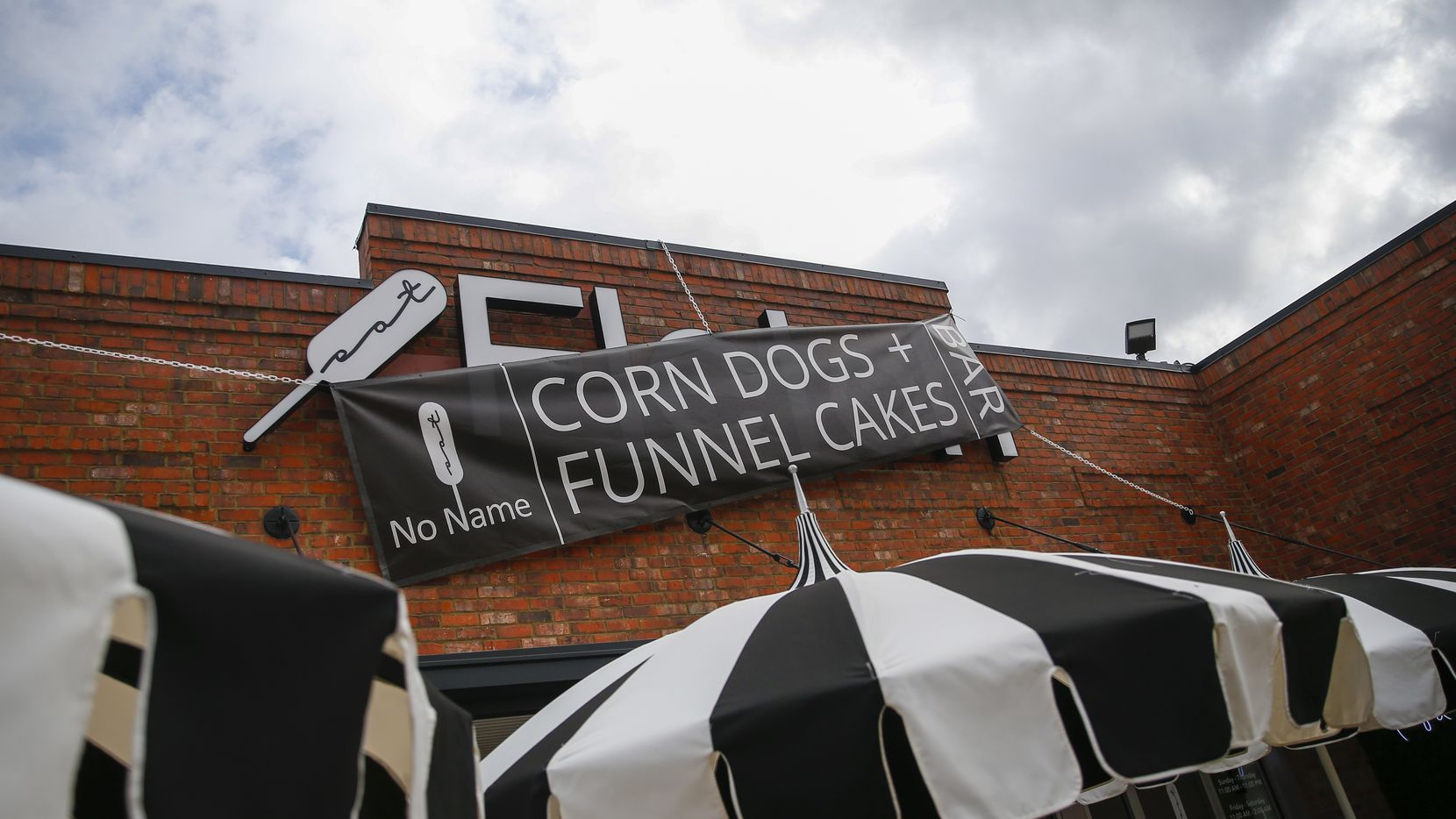 "A sign blocking out the name ""Fletch,"" during an ongoing legal trademark battle, is seen at Corndog With No Name on Wednesday, Jan. 15, 2020 in Dallas. The new restaurant comes from the great-granddaughter of the man who brought Fletcher's corny dogs to the State Fair nearly 80 years ago."