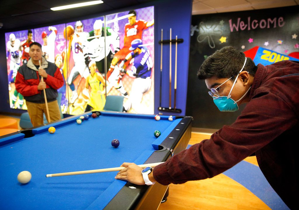David Mojica, 14, of Duncanville (right) plays pool with his older bother Erick Padilla at Children's Medical Center Dallas on Jan. 17, 2019. Mojica suffers from aplastic anemia, a blood disorder which could require a bone marrow transplant. For patients clinging to life, like David, there's a desperate need to find bone marrow donors of Hispanic origin.