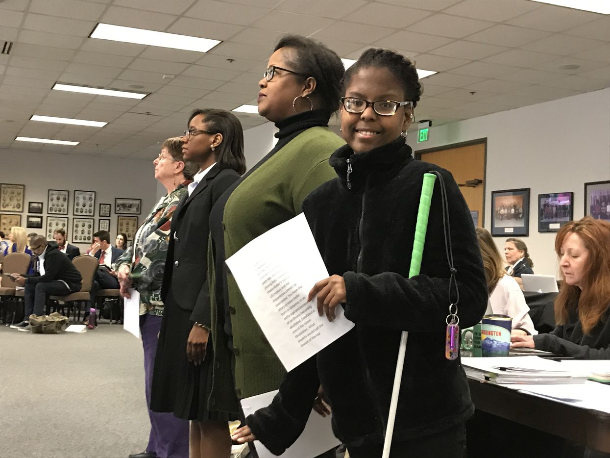 Gabrielle Caldwell, a 17-year-old deaf-blind student, posed with mother Robbie Caldwell at the Texas State Board of Education on Tuesday in the William B. Travis Building in Austin. The Caldwells want Helen Keller to remain in the Texas Essential Knowledge and Skills, or TEKS, for social studies. The TEKS dictate what must be taught to Texas' 5.4 million public schoolchildren.
