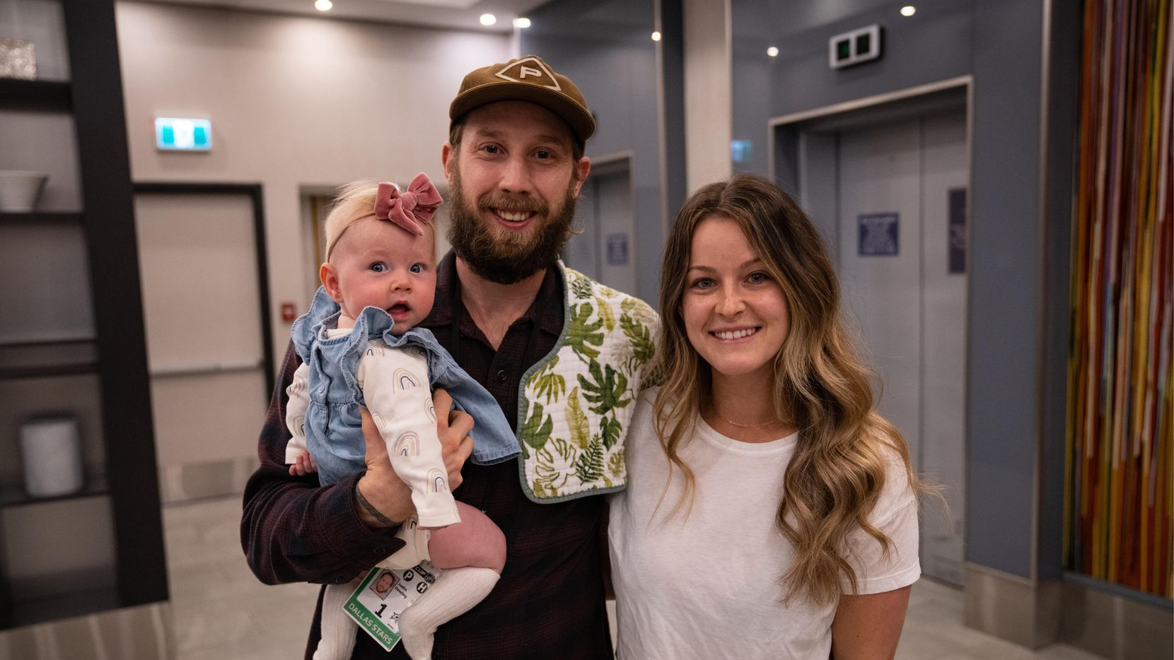 Stars forward Justin Dowling poses with his wife, Meg, and daughter, Perri, after the family reunited in the NHL's Edmonton bubble on Friday, Sept. 11, 2020.