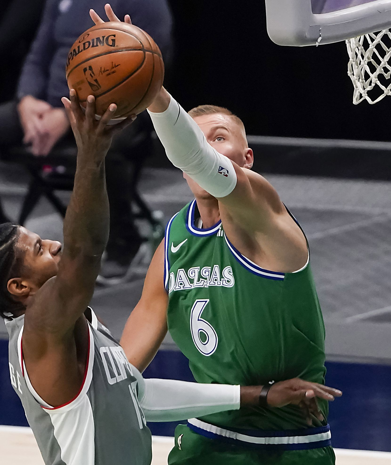 Dallas Mavericks center Kristaps Porzingis (6) defends against LA Clippers guard Paul George (13) during the first quarter of an NBA basketball game at American Airlines Center on Wednesday, March 17, 2021, in Dallas.