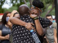 Brilliance Jones cries before getting cleansed by sage while entering Freedman's Memorial Cemetery for vigil honoring those lost as a result of police brutality on Sunday, May 31, 2020 in Dallas. Jones said she felt a lot of anger and was fed up before walking into the cemetery but at the door she knew that while inside she would be safe and surrounded by her ancestors.  (Juan Figueroa/ The Dallas Morning News)