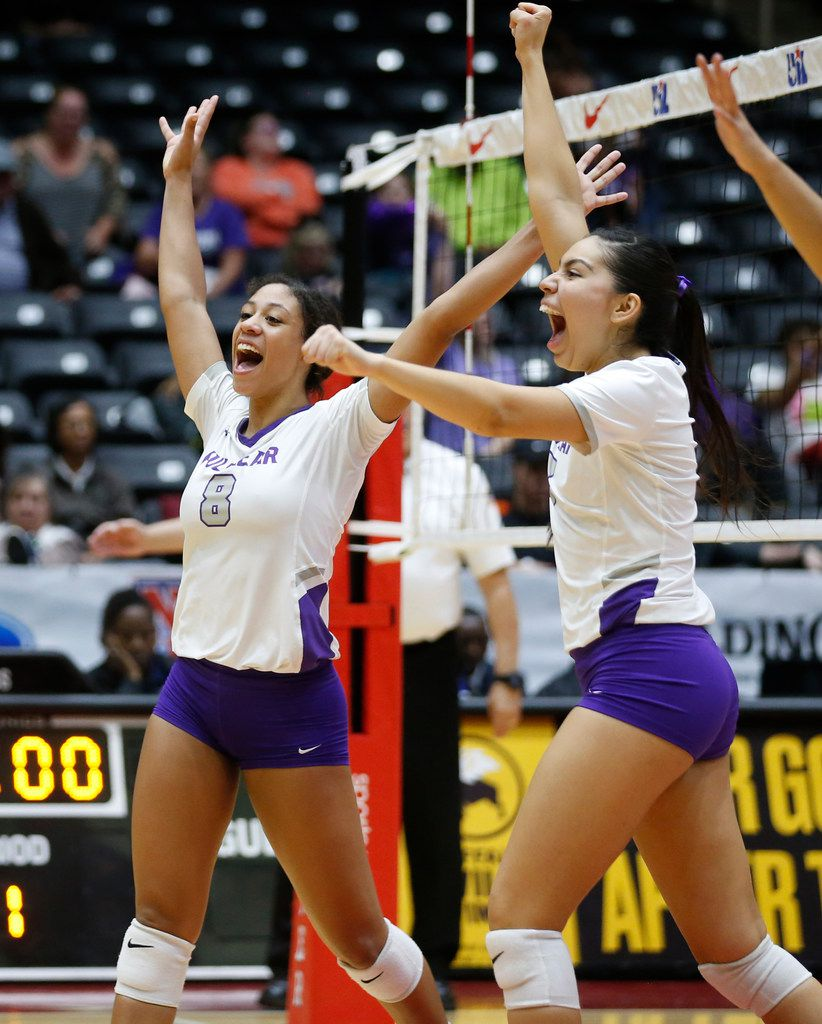 Kennedale Madeline Pyles (3) hits the ball over Lamar FulshearÕs Shelby Tally (13) and Jalile Rodriguez (17) during the second set of a Class 4A volleyball state semifinal match at the Curtis Culwell Center in Garland, on Thursday, November 21, 2019. Fulshear won three straight sets 25-14, 25-11 and 25-20 to advance to the state final.