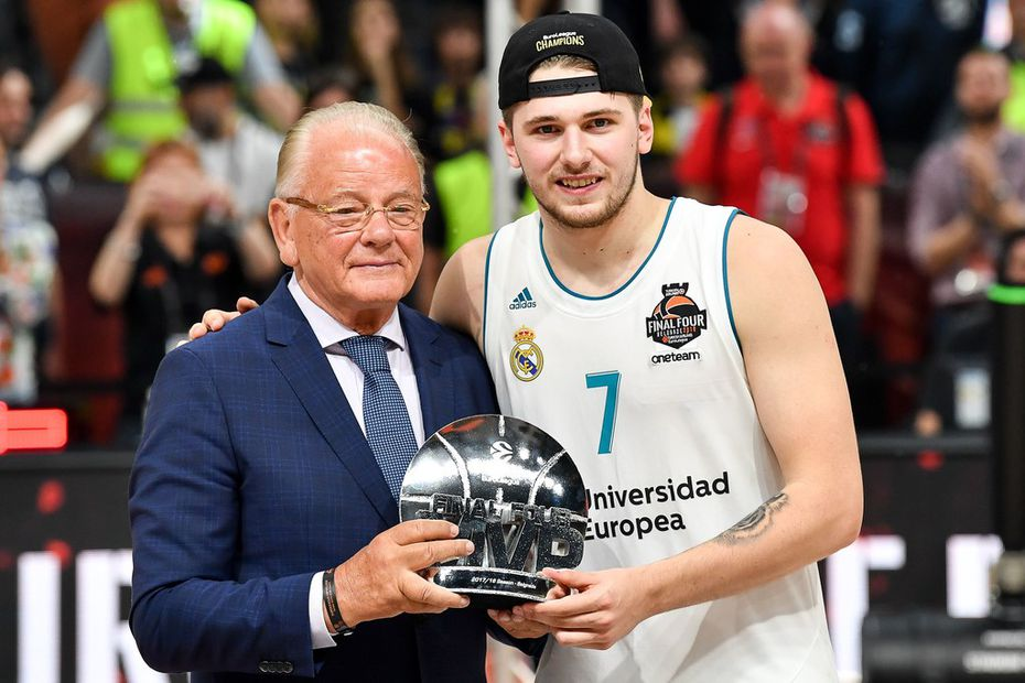 Real Madrid's Slovenian Luka Doncic poses for a photograph with the team's President Florentino Perez as they celebrate their 85-80 win over Fenerbahce in the Euroleague Final Four finals basketball match between Real Madrid and Fenerbahce Dogus Istanbul at The Stark Arena in Belgrade on May 20, 2018. / AFP PHOTO / Andrej ISAKOVICANDREJ ISAKOVIC/AFP/Getty Images