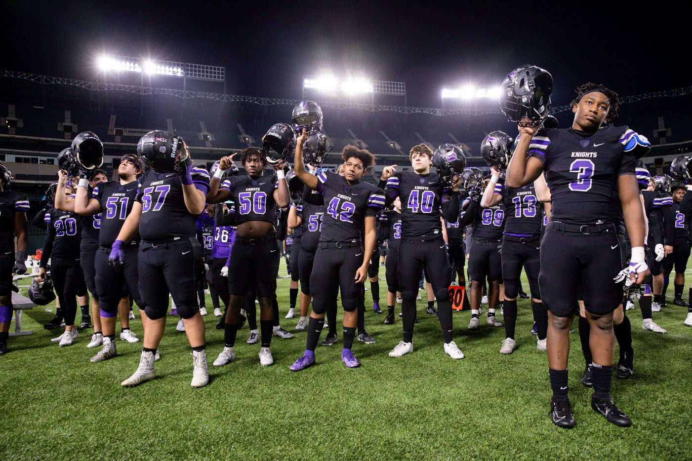 Frisco Independence players sing their school song after losing a Class 5A Division I area-round playoff game against Highland Park  at Globe Life Park in Arlington on Thursday, Dec. 17, 2020. Highland Park won 42-20. (Juan Figueroa/ The Dallas Morning News)