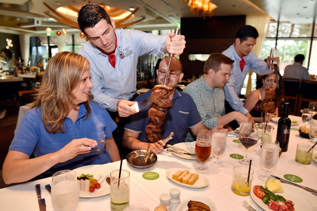 Gaucho Lucas Guski slices a piece of picanha for customer Kate Stein at the new Fogo de Ch‹o in Uptown, Friday, May 19, 2017 in Dallas. Ben Torres/Special Contributor