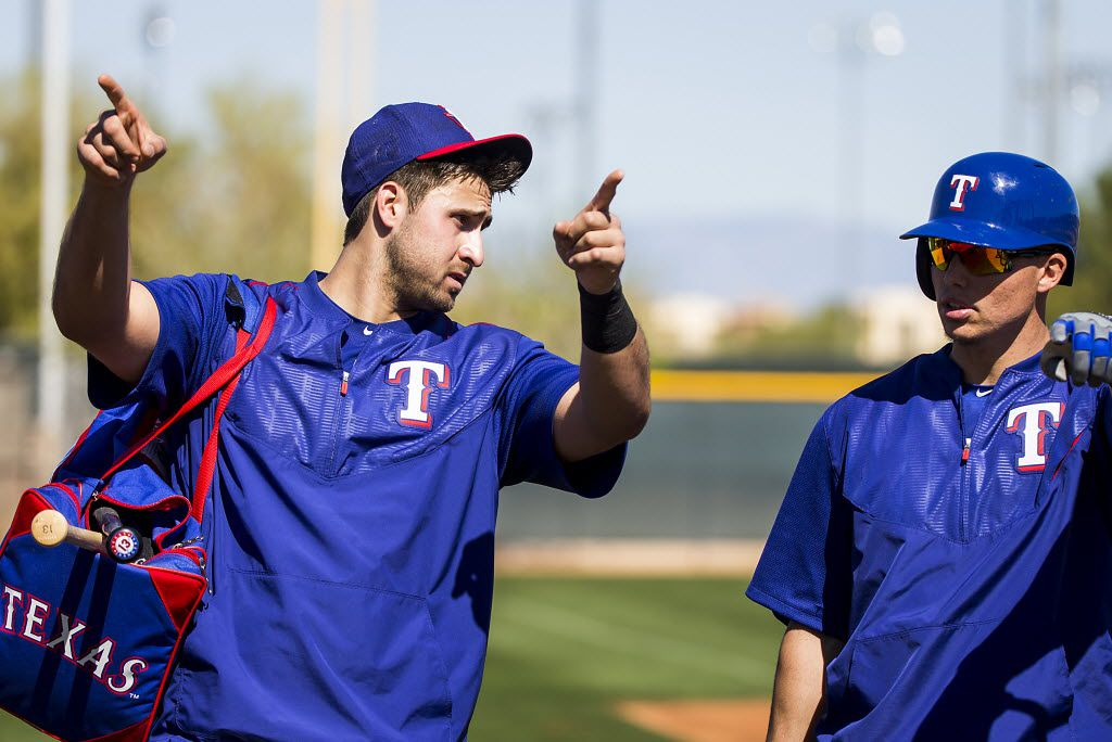 Texas Rangers outfielder Joey Gallo (right) talks with infielder Drew Robinson during a spring training workout at the team's training facility on Thursday, Feb. 25, 2016, in Surprise, Ariz.