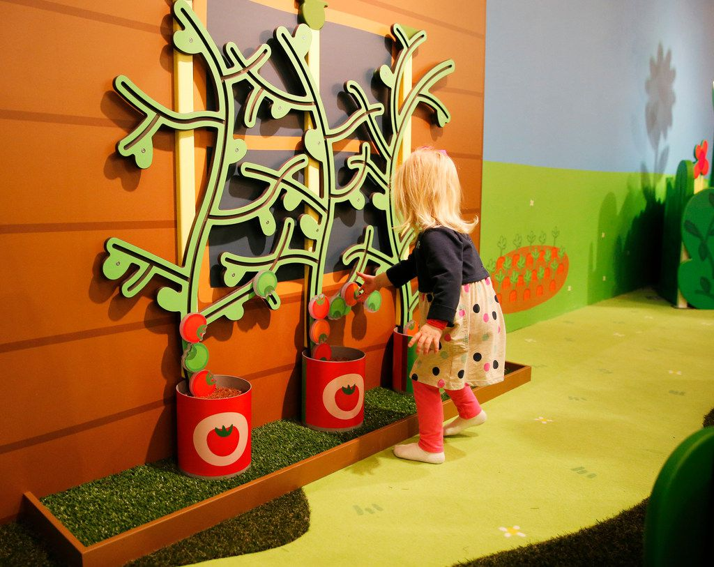Blaire Lucich, 2 of Hurst plays with an interactive garden exhibit at Peppa Pig World of Play at Grapevine Mills in Grapevine. This is the United States' first permanent Peppa Pig exhibit. Peppa is a very popular kids' cartoon.