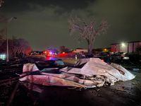 High winds in Arlington scattered debris from an apartment complex's roof along Pioneer Parkway near Center and Collins streets Tuesday night.