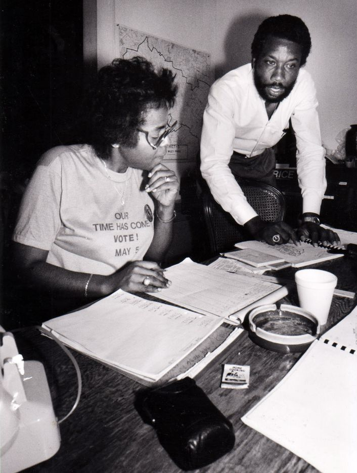 In an undated photo, John Wiley Price looks over election returns with campaign worker Betty Culbreath at his headquarters on election night.