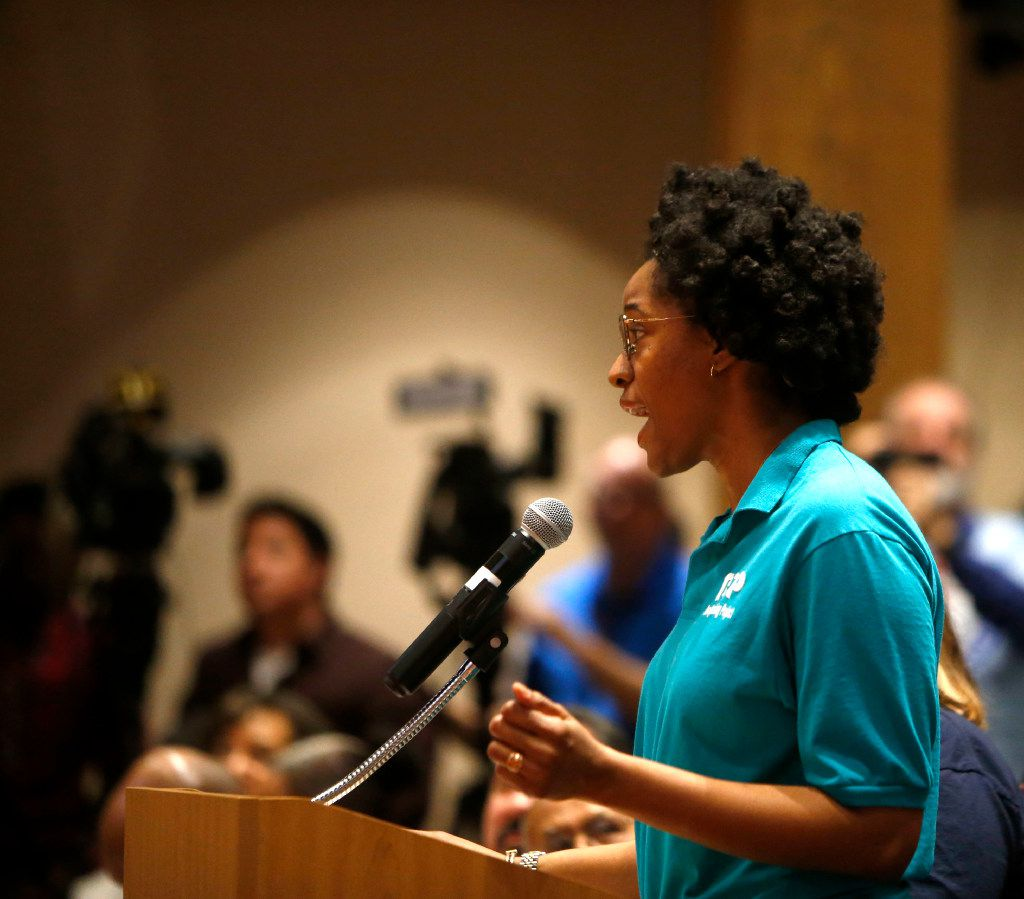"""Brianna Brown, deputy director of the Texas Organizing Project, spoke in support of the """"A Welcoming Communities"""" resolution during a meeting at the Dallas County Commissioners Court on Feb. 7, 2017."""