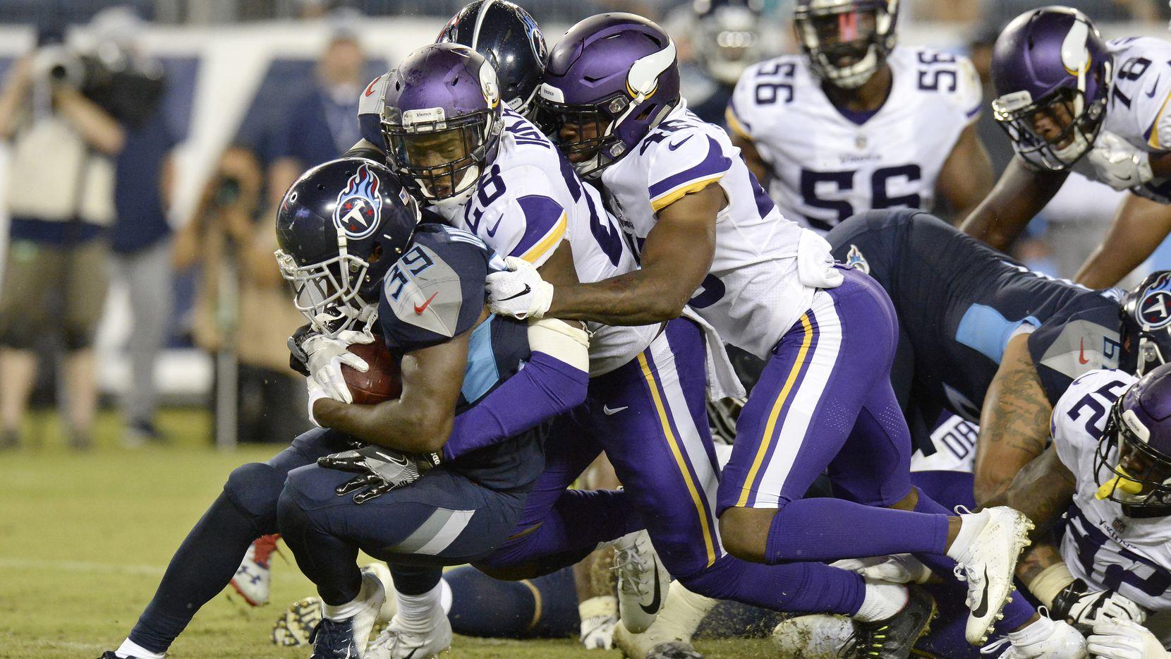 FILE - Tennessee Titans running back Dalyn Dawkins (39) is stopped by Minnesota Vikings defensive back George Iloka (28) in the second half of a preseason NFL football game Thursday, Aug. 30, 2018, in Nashville, Tenn. (AP Photo/Mark Zaleski)