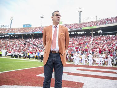 Texas Longhorns athletic director Chris Del Conte  looks on during pregame of an NCAA college football game  against Oklahoma Sooners at the Cotton Bowl Stadium in Dallas Texas on Saturday, Oct. 6, 2018.