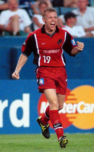 ORG XMIT: S0332345932_WIRE Dallas Burn forward Bobby Rhine celebrates his goal against the New England Revolution in the first half at Foxboro Stadium in Foxboro, Mass., Wednesday, Aug. 2, 2000. Dallas won 2-1.