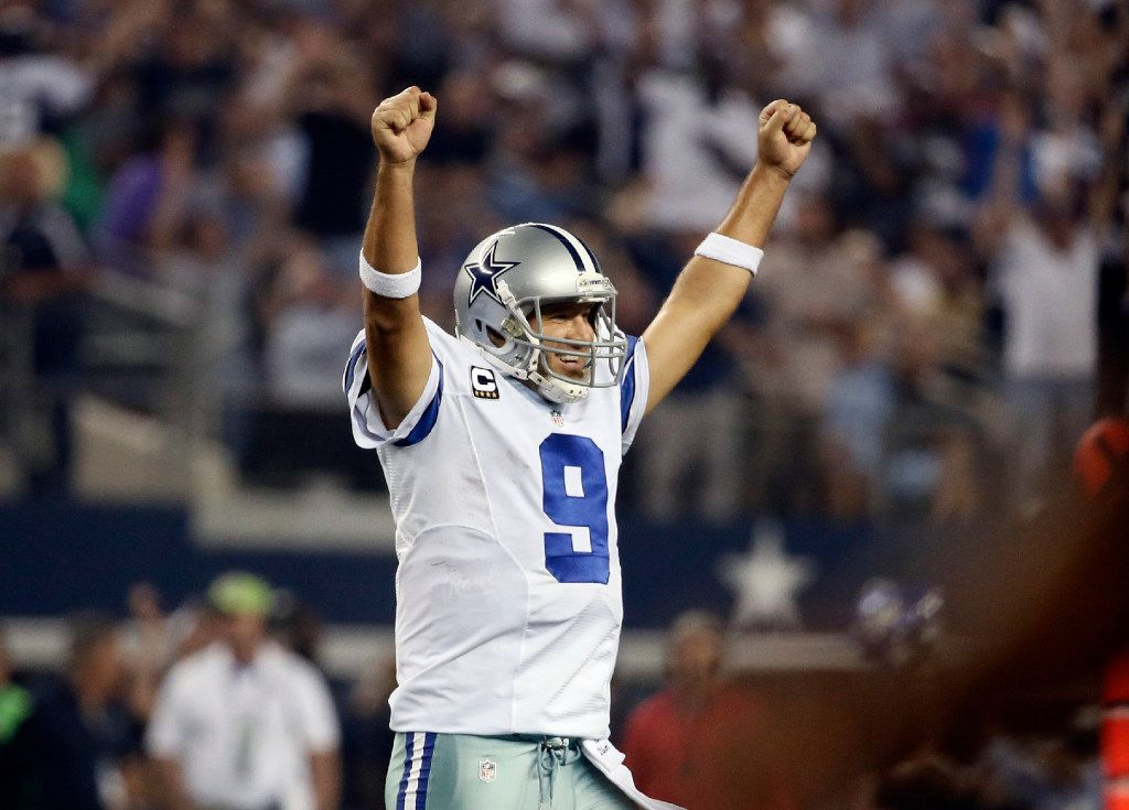 Tony Romo celebrates a touchdown run by DeMarco Murray during the second half of an NFL football game against the New Orleans Saints,  in Arlington, Texas.(AP Photo/Brandon Wade, File)