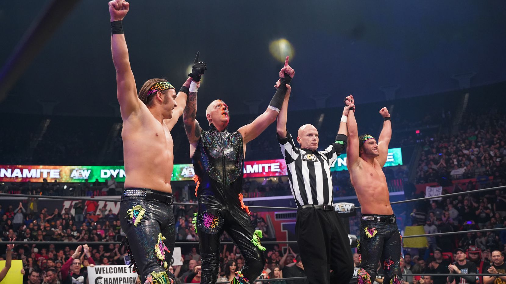 Dustin Rhodes celebrates with the Young Bucks after a victory on AEW Dynamite.