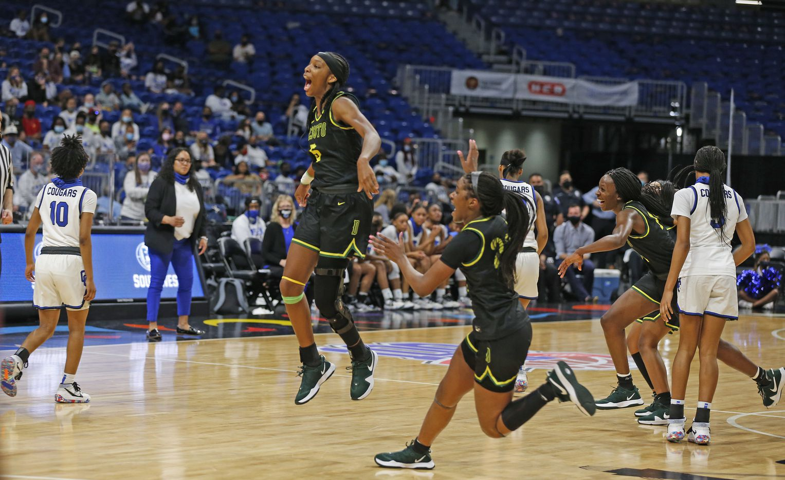 DeSoto Sa'Myah Smith #5 leaps in the air after defeating Cypress Creek. DeSoto vs. Cypress Creek girls basketball Class 6A state championship game on Thursday, March 12, 2021 at the Alamodome.