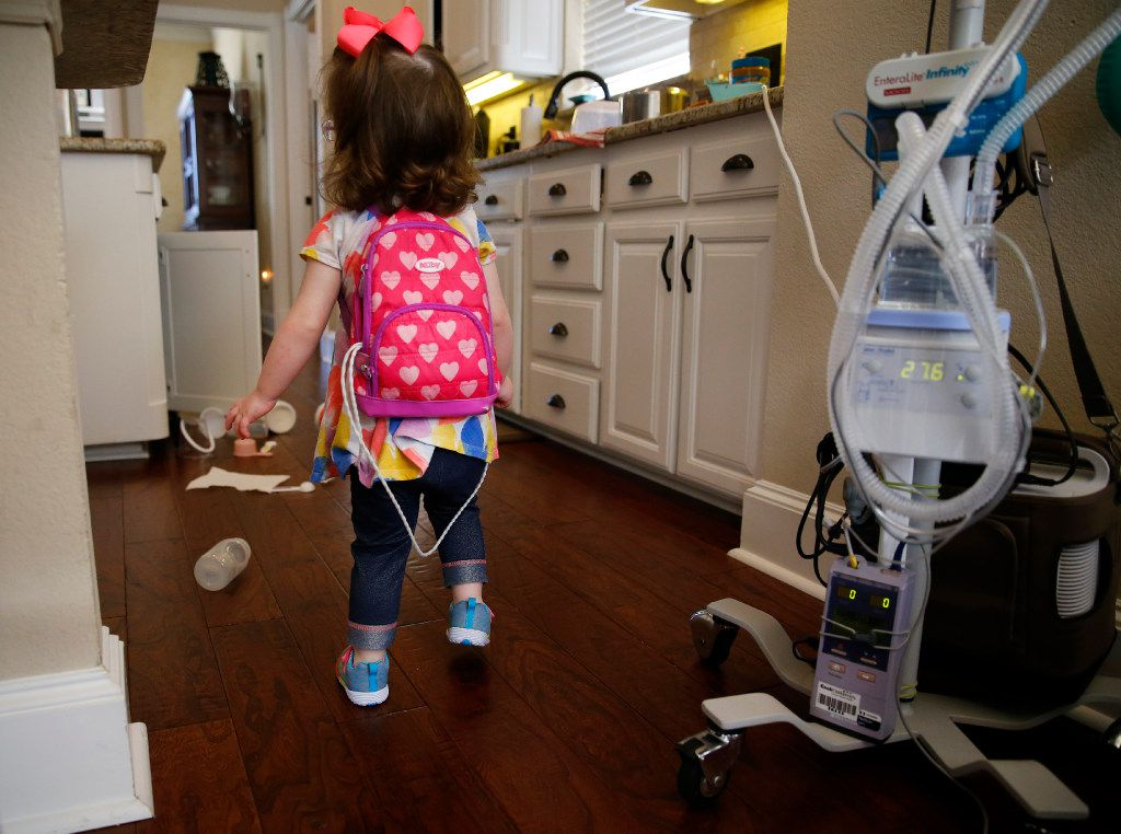 Two-year-old Christina Gregory has to carry a diaphragmatic pacemaker in a backpack to keep her breathing on track. She needs 24-hour medical care because she suffers from CCHS (congenital central hypoventilation syndrome), a genetic disorder that affects her breathing. The Gregorys have two pediatric nurses that work around the clock to keep a watchful eye on Christina at their Southlake home. (Tom Fox/Staff Photographer)