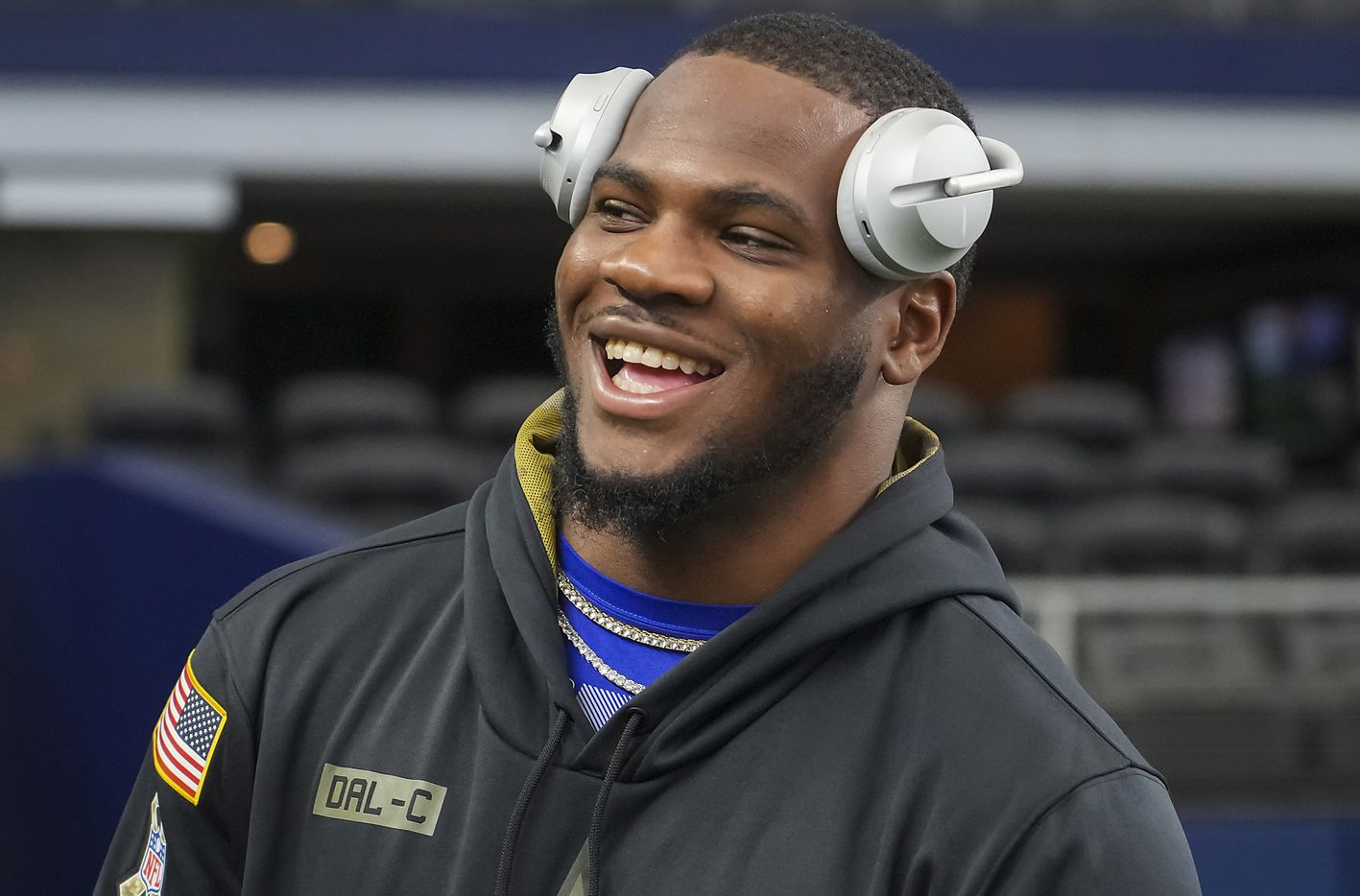 Dallas Cowboys linebacker Micah Parsons laughs with Shannon Furman of HBO's Hard Knocks as players warm up before a preseason NFL football game against the Jacksonville Jaguars at AT&T Stadium on Sunday, Aug. 29, 2021, in Arlington. (Smiley N. Pool/The Dallas Morning News)