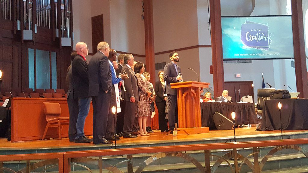 Imam Omar Suleiman accepts the Bishop Oden Award from the North Texas Conference of the United Methodist Church on behalf of Faith Forward Dallas.