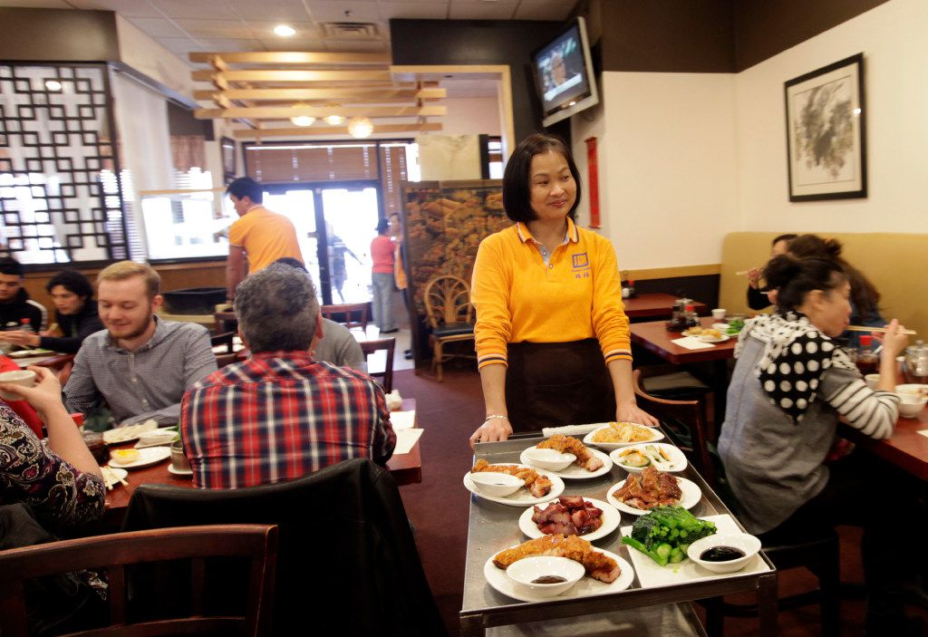 Ling He serves guests at J.S. Chen's Dim Sum and BBQ in Plano.