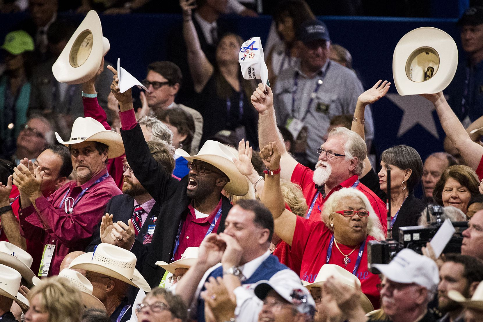 Texas delegates celebrate as Donald Trump formally becomes the nominee for president at the Republican National Convention on July 19, 2016, in Cleveland.