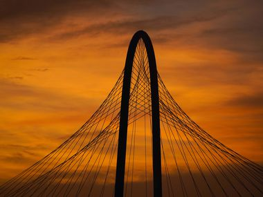 The lingering colors of sunset silhouette the Margaret Hunt Hill Bridge on Tuesday, June 30, 2020, in Dallas. Dissipating Saharan dust passing through North Texas continues to enhance sunrises and sunsets. The dust plume is a mass of dry air, known as the Saharan Air Layer, that forms every year over the Sahara Desert and moves toward the Atlantic, according to the National Oceanic and Atmospheric Administration.