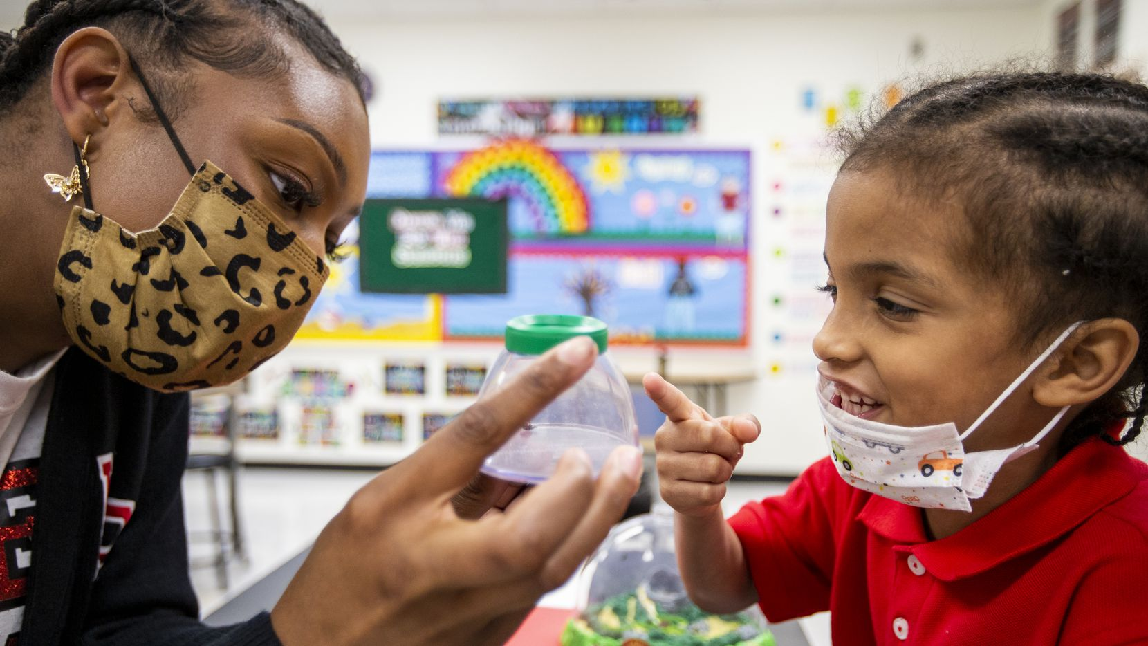 Pre-Kindergarten assistant teacher Alexis Alexander shows Prosper Gilkey a close up view of a ladybug during a science lab at High Pointe Elementary School in Cedar Hill. Last month, Texas added 11,300 jobs in government -- among the highlights in April's jobs report.