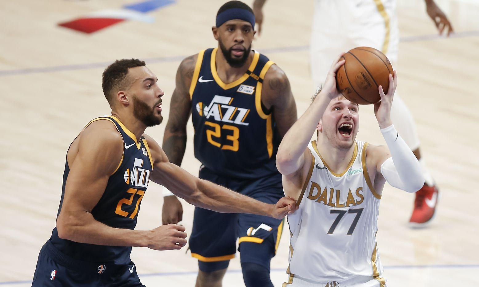 Dallas Mavericks guard Luka Doncic (77) attempts a shot as Utah Jazz forward Rudy Gobert (27) defends during the second half of an NBA basketball game in Dallas, Monday, April 5, 2021. (Brandon Wade/Special Contributor)