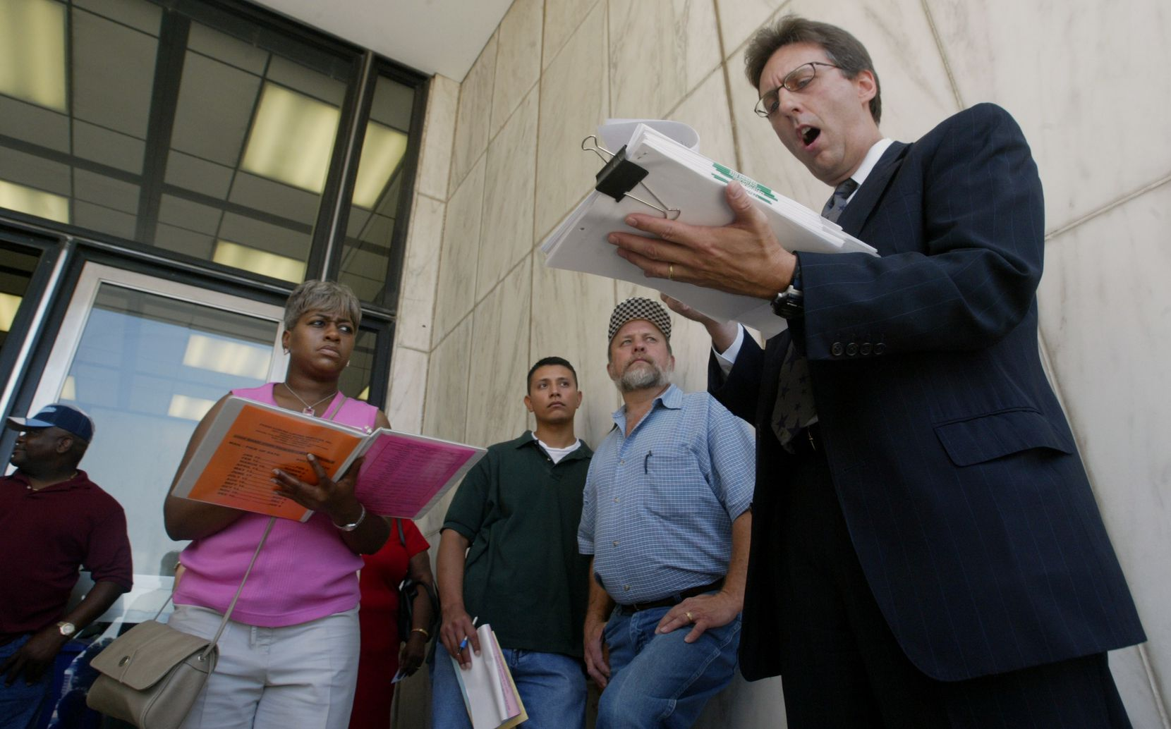 Foreclosure auctions like this one are typically held on the steps of the George Allen Courthouse in downtown Dallas on the first Tuesday of every month.
