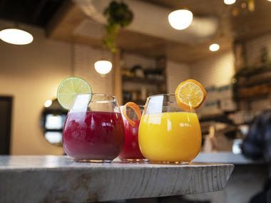 The juice beverages Beats, left, Pony Ride and Medicine Man, right, from Tribal Cafe All Day Cafe in the Bishop Arts district of Dallas.