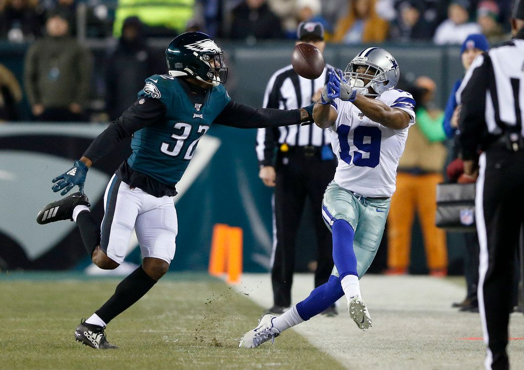 Dallas Cowboys wide receiver Amari Cooper (19) reaches for an overthrown ball from Dallas Cowboys quarterback Dak Prescott (4) as Philadelphia Eagles cornerback Rasul Douglas (32) defends during the second half of play at Lincoln Financial Field in Philadelphia on Sunday, December 22, 2019. Philadelphia Eagles defeated the Dallas Cowboys 17-9. (Vernon Bryant/The Dallas Morning News)