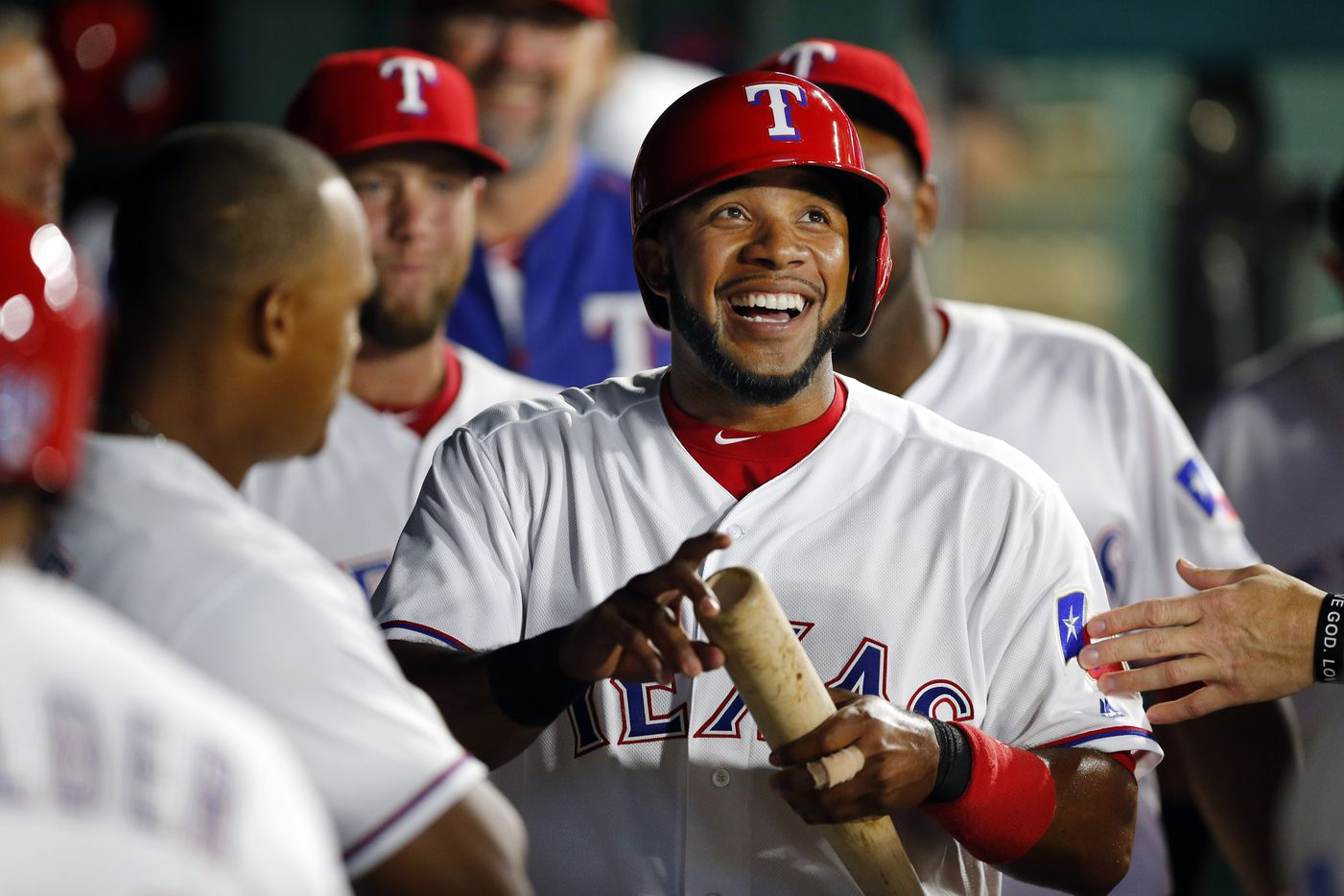 Texas Rangers shortstop Elvis Andrus (1) smiles big as he is congratulated by teammates after scoring on a double by Texas Rangers Brett Nicholas in the sixth inning at the Globe Life Park in Arlington, Tuesday, April 19, 2016. (Tom Fox/The Dallas Morning News)