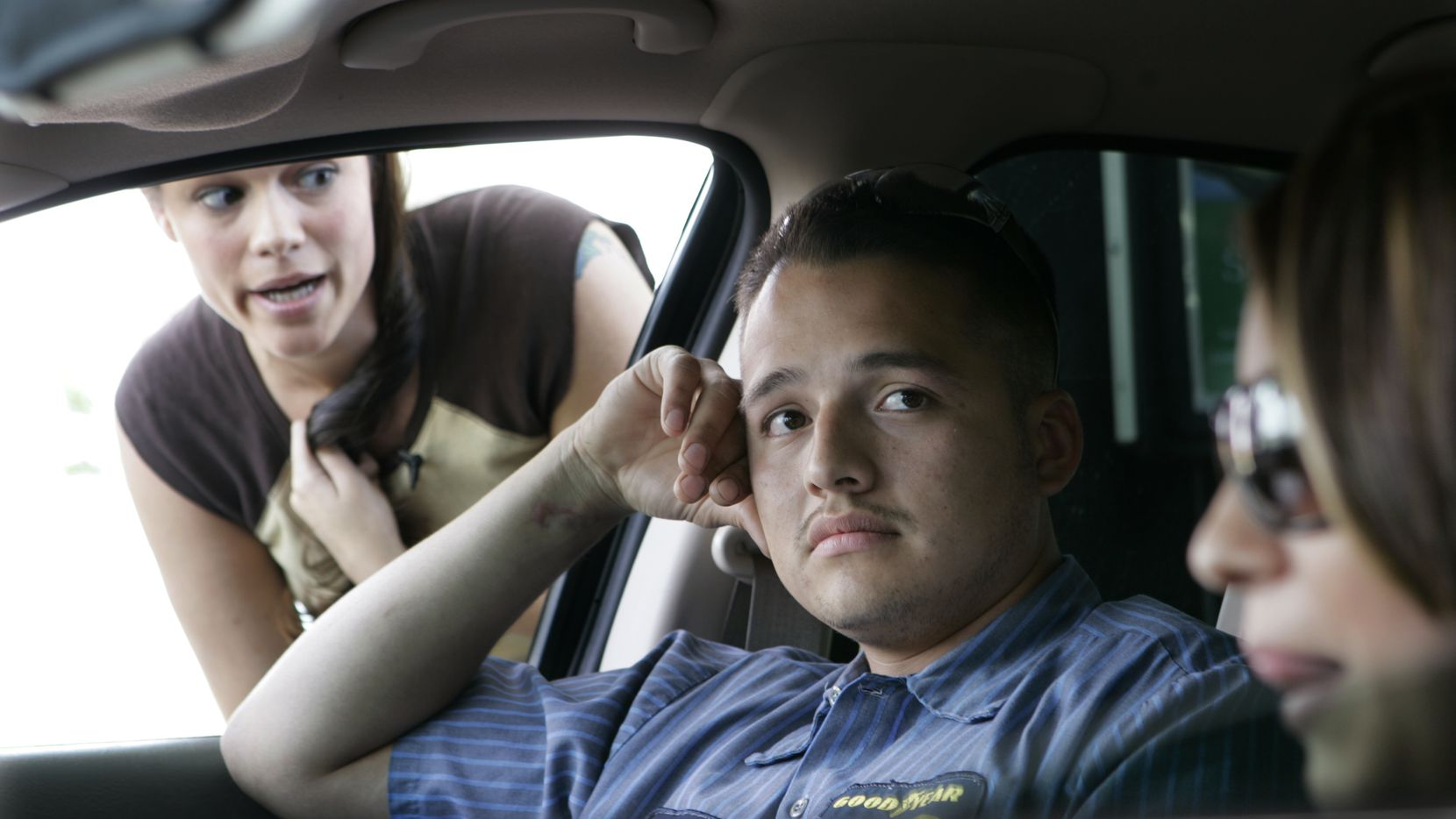 """In this 2005 file photo, Alicia Smith (left) confronts Luis Hernandez (middle) during filming on an episode of """"Cheaters."""""""