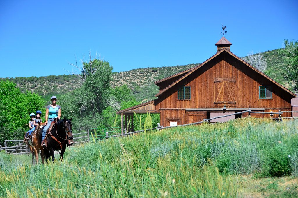 Guests leave the barn for a trail ride at Smith Fork Ranch.