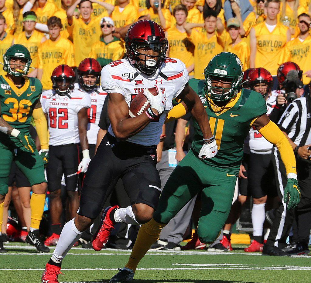 Texas Tech wide receiver Erik Ezukanma (84) runs past Baylor cornerback Jameson Houston (11) during the first half of a NCAA college football game in Waco, Tex.,Saturday, Oct. 12, 2019.