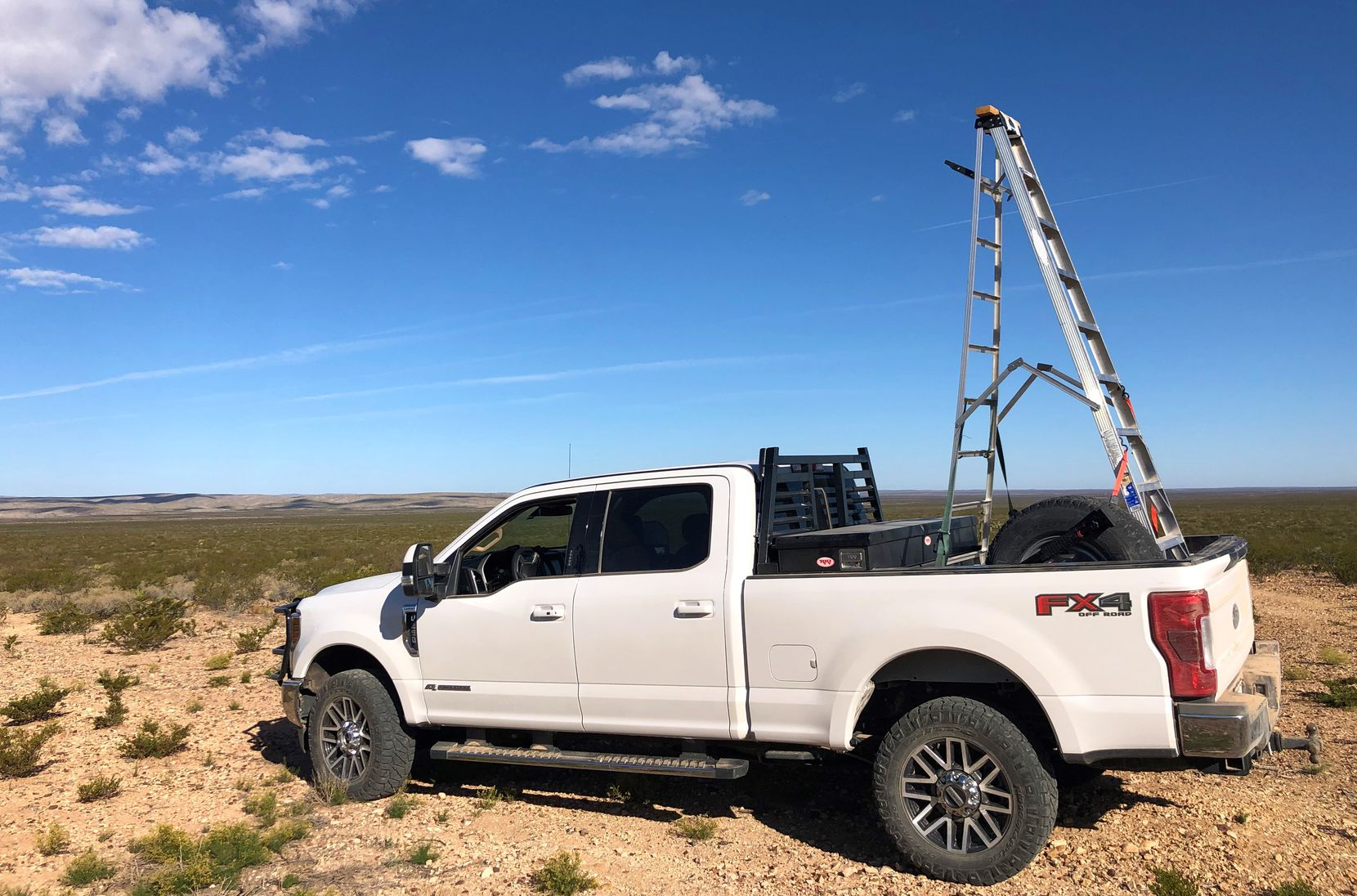 Greg Simons relied on a makeshift spotting platform fashioned from a 12-foot step ladder to provide a clearer view of the brushy Trans-Pecos landscape.