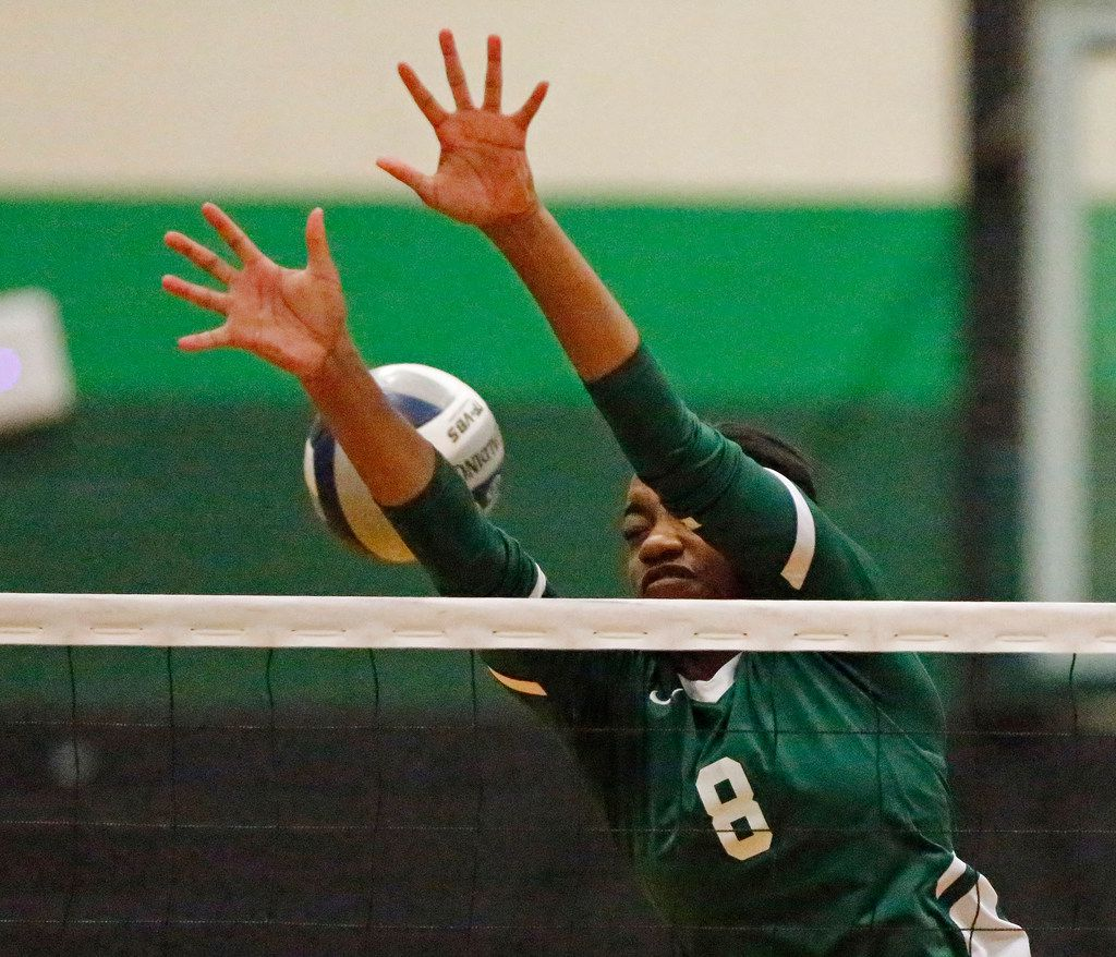 Lebanon Trail High School opposite Tyrah Ariail (8) attempts a block during game three as Lebanon Trail High School played Highland Park High School in a Class 5A Region II quarterfinal match played at Richardson Berkner High School on Monday night, November 12, 2019. (Stewart F. House/Special Contributor)