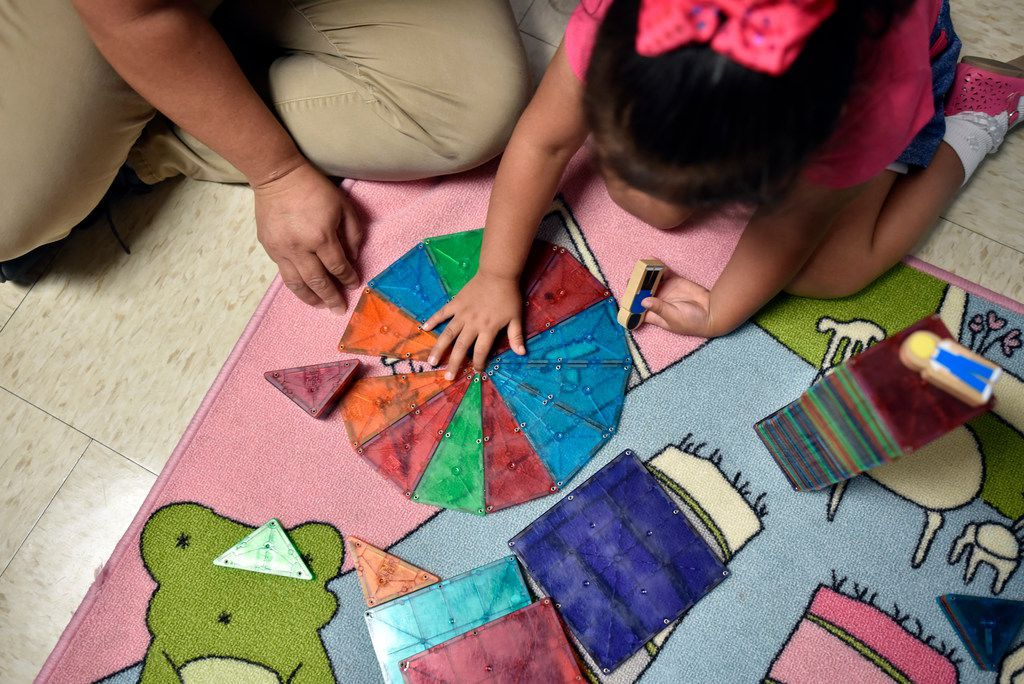 Patricia Vega works with daughter Elizabeth Diaz, 3, on educational activities to help her understand colors at the Bachman Lake Together Family Center in Dallas. (Ben Torres/Special Contributor)