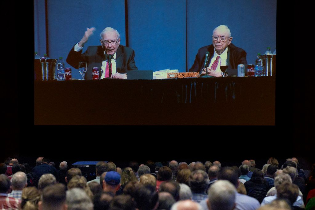 Shareholders in an overflow room watch on a big screen as Berkshire Hathaway chairman and CEO Warren Buffett, left, and vice chairman Charlie Munger preside over the annual Berkshire Hathaway shareholders meeting. Buffett and Munger spent hours answering questions.