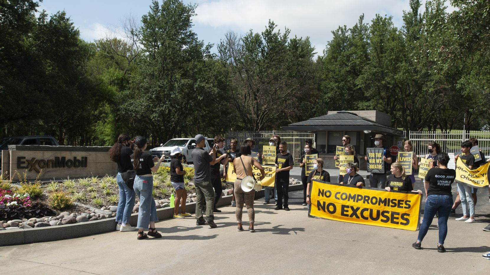 Members of the Sunrise Movement, a youth group formed for action on climate change, protested outside the front gate of ExxonMobil headquarters in Irving on Thursday, July 15, 2021.